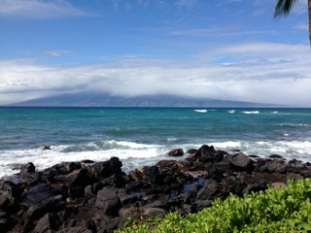 view of Molokai from West Maui. choppier waters today, due to 20 mph winds.